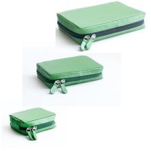 Dosettfodral i skinn Grön